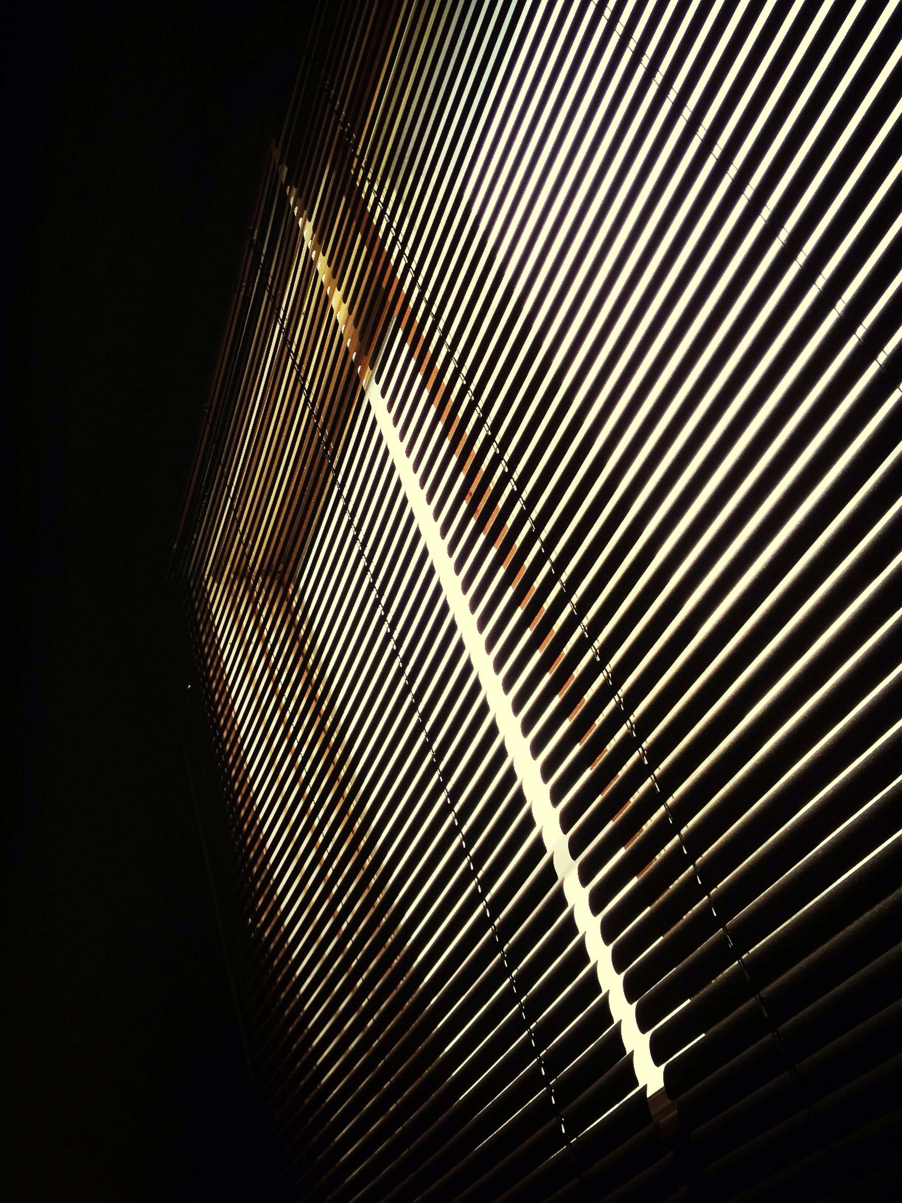 low angle view, pattern, illuminated, night, modern, built structure, architecture, indoors, design, metal, abstract, backgrounds, repetition, lighting equipment, no people, full frame, electricity, technology, light - natural phenomenon, metallic