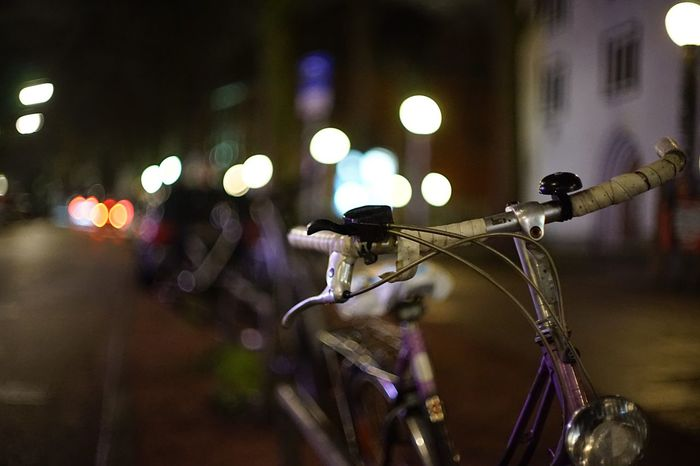Old lost Bicycle EyeEm Selects Bicycle Mode Of Transport Transportation Night Land Vehicle Illuminated Street Focus On Foreground No People Outdoors Building Exterior Architecture Built Structure Close-up City Stationary