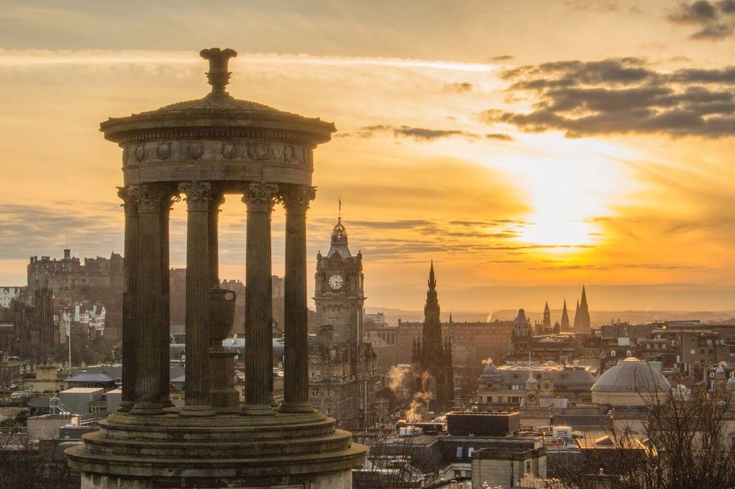 The sun setting over Edinburgh, taken from Calton Hill. Edinburgh Edinburgh Castle Scotland VisitScotland Calton Hill Dugald Stewart Monument Scott Monument Balmoral Hotel Sunset First Eyeem Photo The City Light