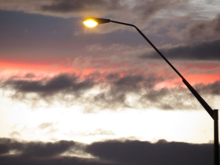 Cloud - Sky Sunset No People Beauty In Nature Silhouette Sky Outdoors Nature Cold Temperature Day Streetlight Coral Grey Looking Up Ablaze Fire Clouds Illuminated Street Photography Street Street Lamp Aotearoa Evening Light Lamp