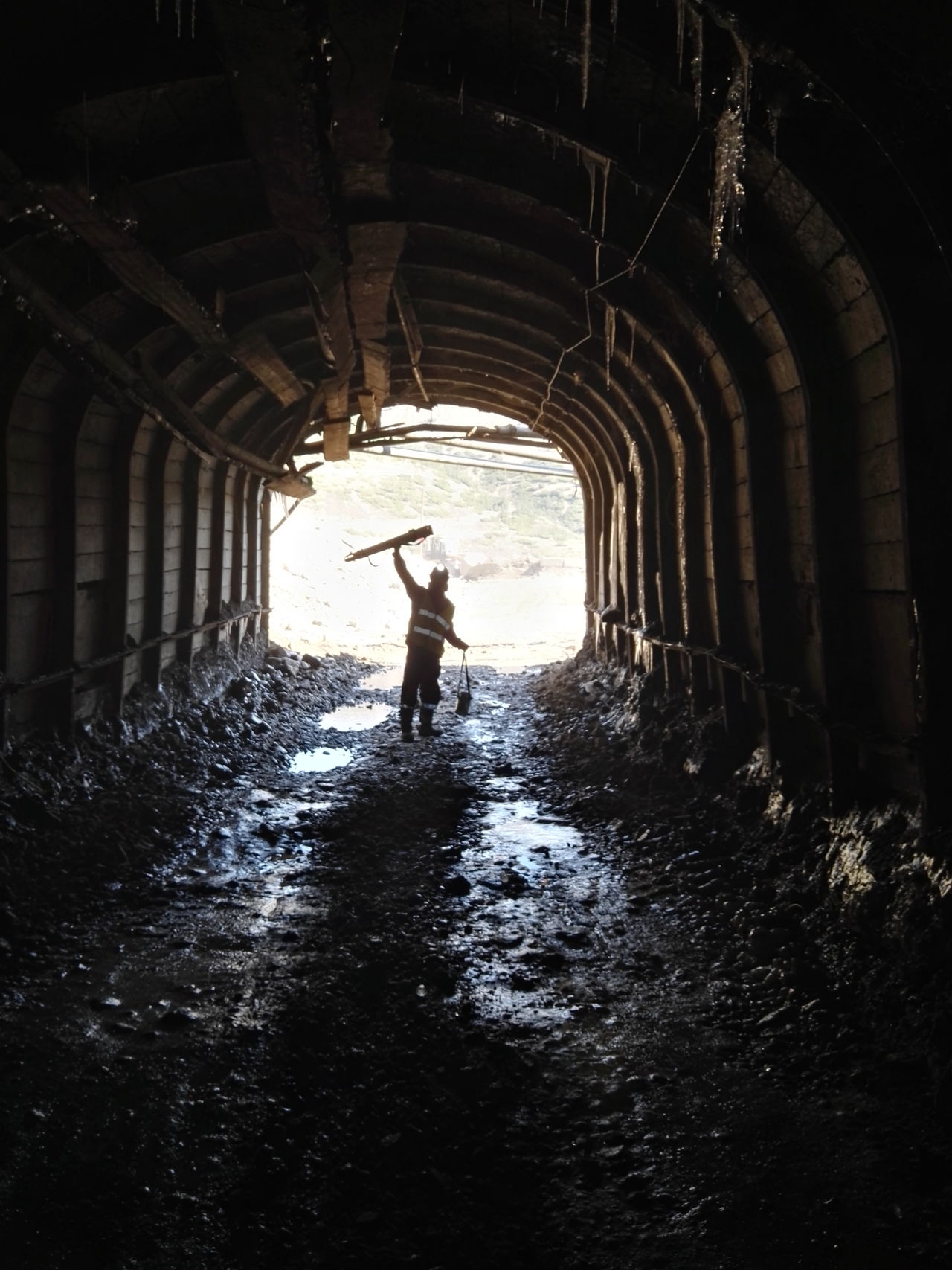 Alive  Dark Darkness Darkness And Light Dirty Engineering Figure Full Length Icicles Industry Light Mine Mining Mining Industry Mountain One Person Outline Real People Road Shadow Shadows & Lights Silhouette Tunnel Worker Workers