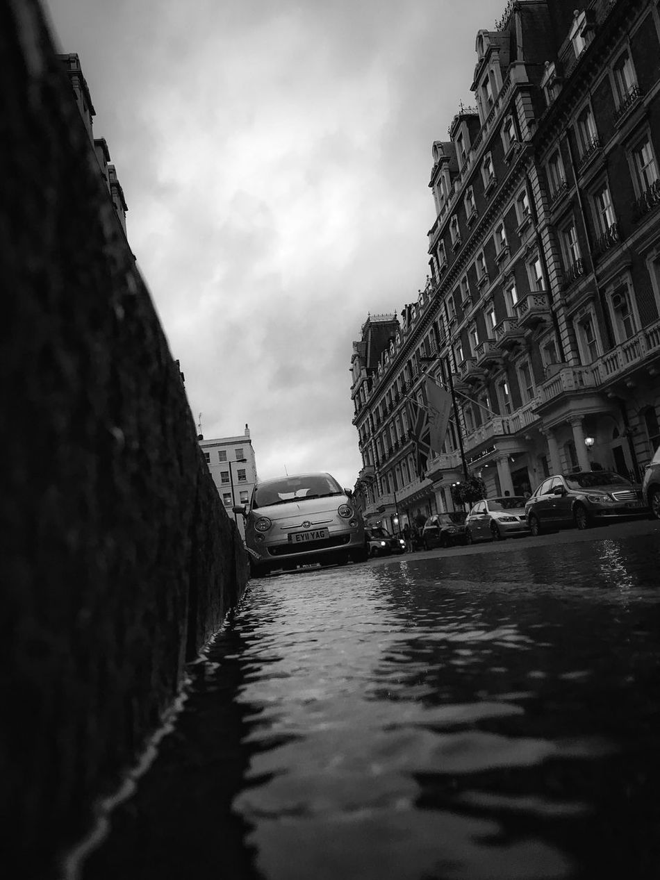 London From The Gutter Reflections Fine Art Photography Parked Cars Architecture Black And White Fresh On Eyeem  Fine Art The Week Of Eyeem Vanishing Point EyeEm Best Shots - The Streets Urban Exploration EyeEm Best Shots - Architecture EyeEmBestPics Buildings & Sky Street Photography Re Edited Darkness Urban EyeEm Best Shots - Black + White Curbside Running Water