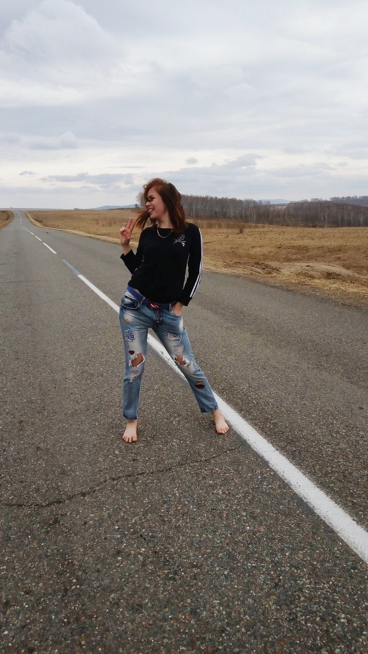 one person, sky, full length, lifestyles, real people, leisure activity, casual clothing, cloud - sky, road, young women, young adult, landscape, outdoors, nature, day, people