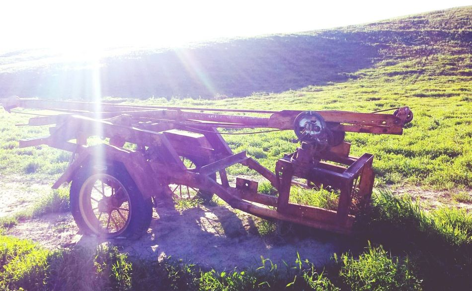Check This Out Farming Look At This Random Things Worth Capturing Old Farm Machinery Antique Farm Equipment In The Middle Of A Light. Sun Shing Down On Me Sunlite Sunlit Abandoned Look What We Found Tools In Nature Hills And Valleys Bright Sun Shine Cool Capture