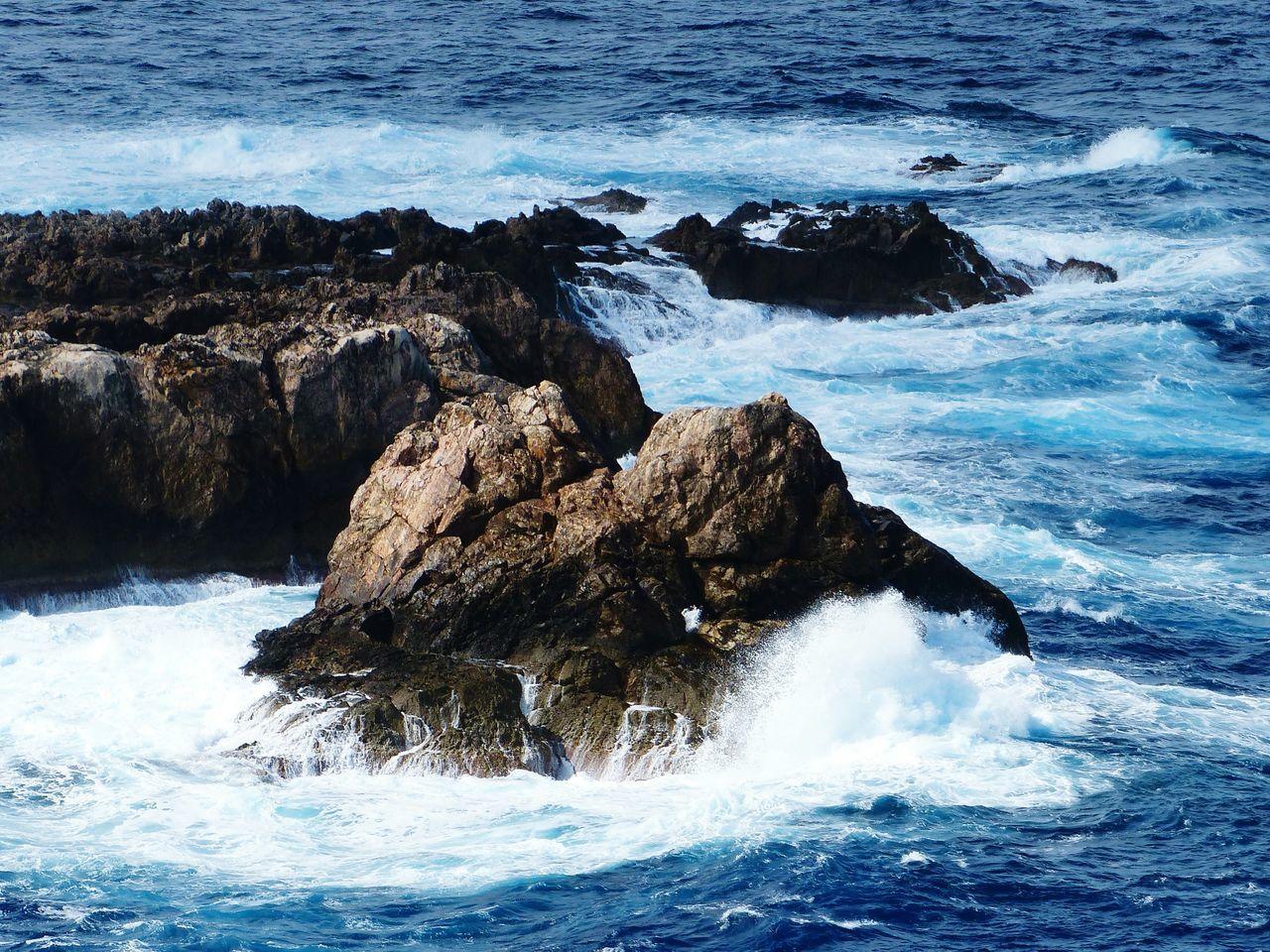 Waves Splashing Rocks At Sea