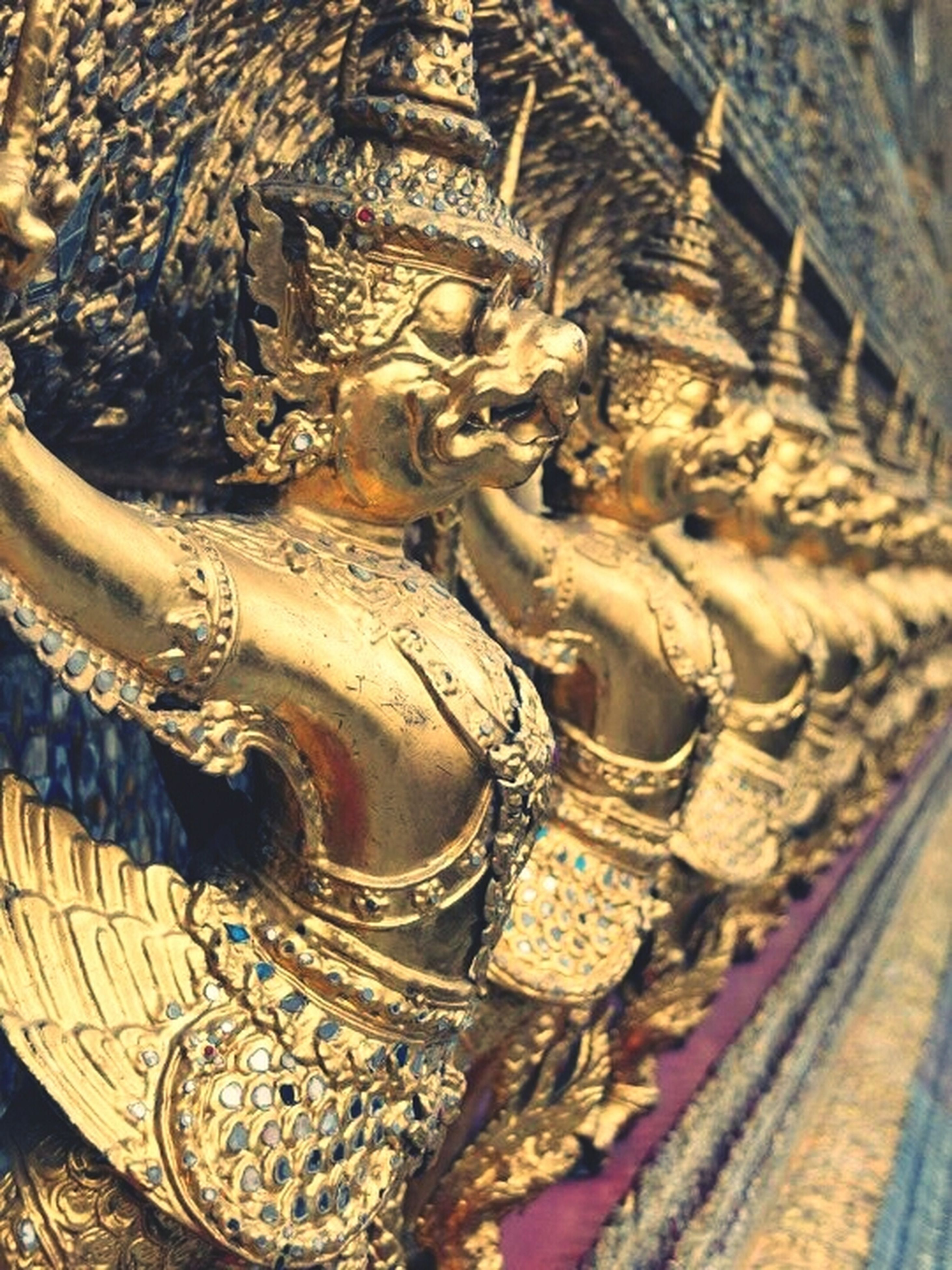 art and craft, art, statue, sculpture, creativity, human representation, religion, carving - craft product, spirituality, place of worship, low angle view, famous place, architecture, temple - building, built structure, history, ornate, gold colored