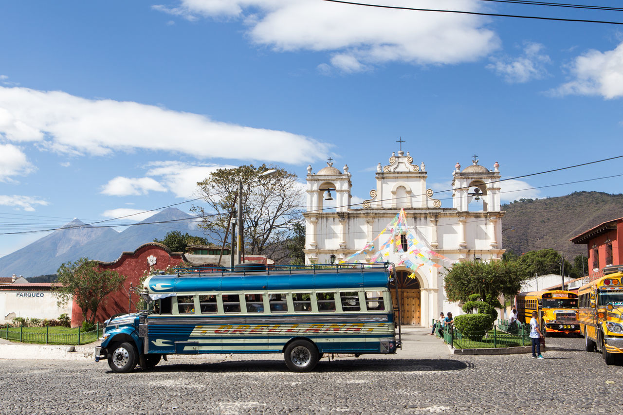 Chicken bus in front of a church in Antigua, Guatemala. Architecture Blue Bus City Cloud - Sky Day Outdoors Sky Transportation Transportation Travel Travel Destinations Traveling