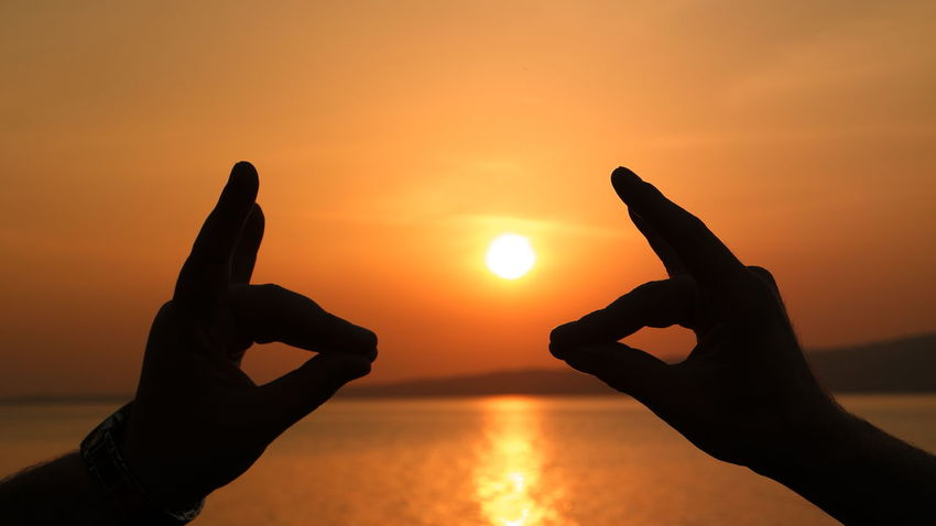 Bozkurt Cloud - Sky EyeEmTurkey Hand Sign MHP Orange Color Outdoors Person Sea Sun Sunset Sun_collection Sunset_collection Taking Photos