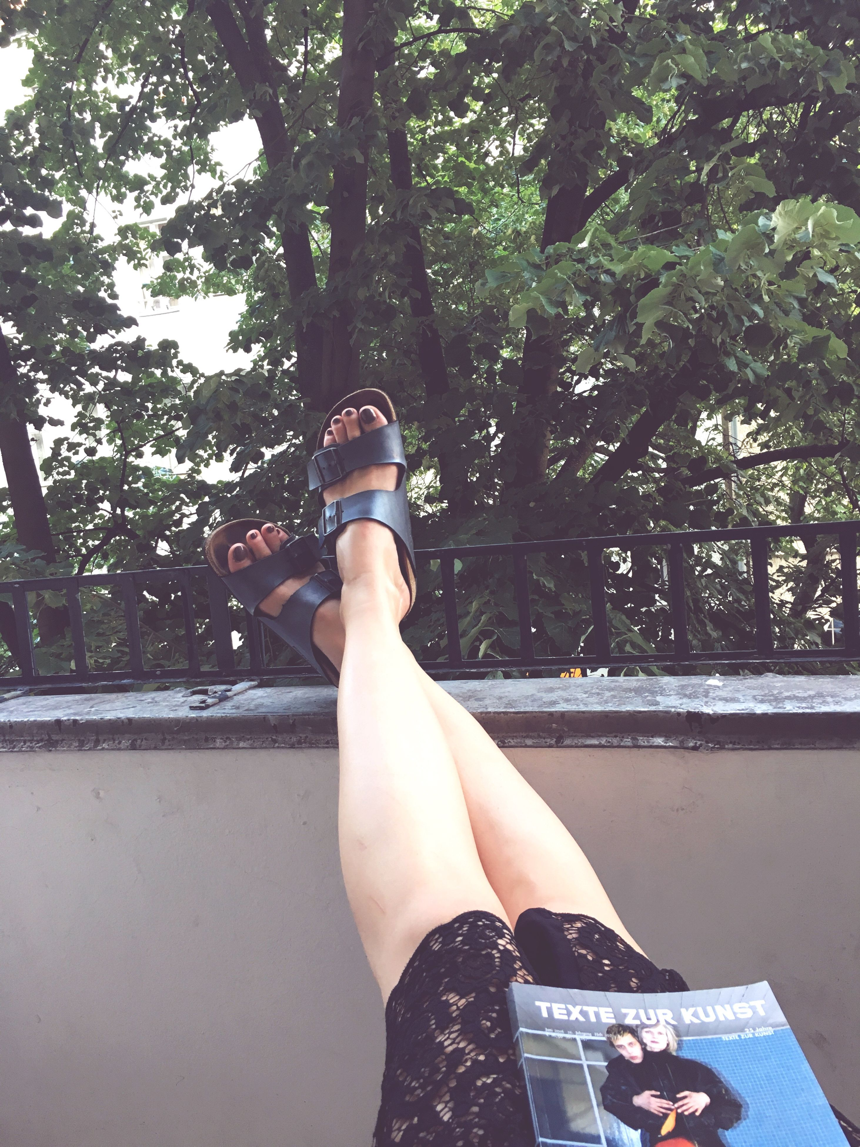 lifestyles, low section, personal perspective, person, tree, leisure activity, relaxation, standing, shoe, legs crossed at ankle, sitting, day, sunlight, outdoors, part of, human foot