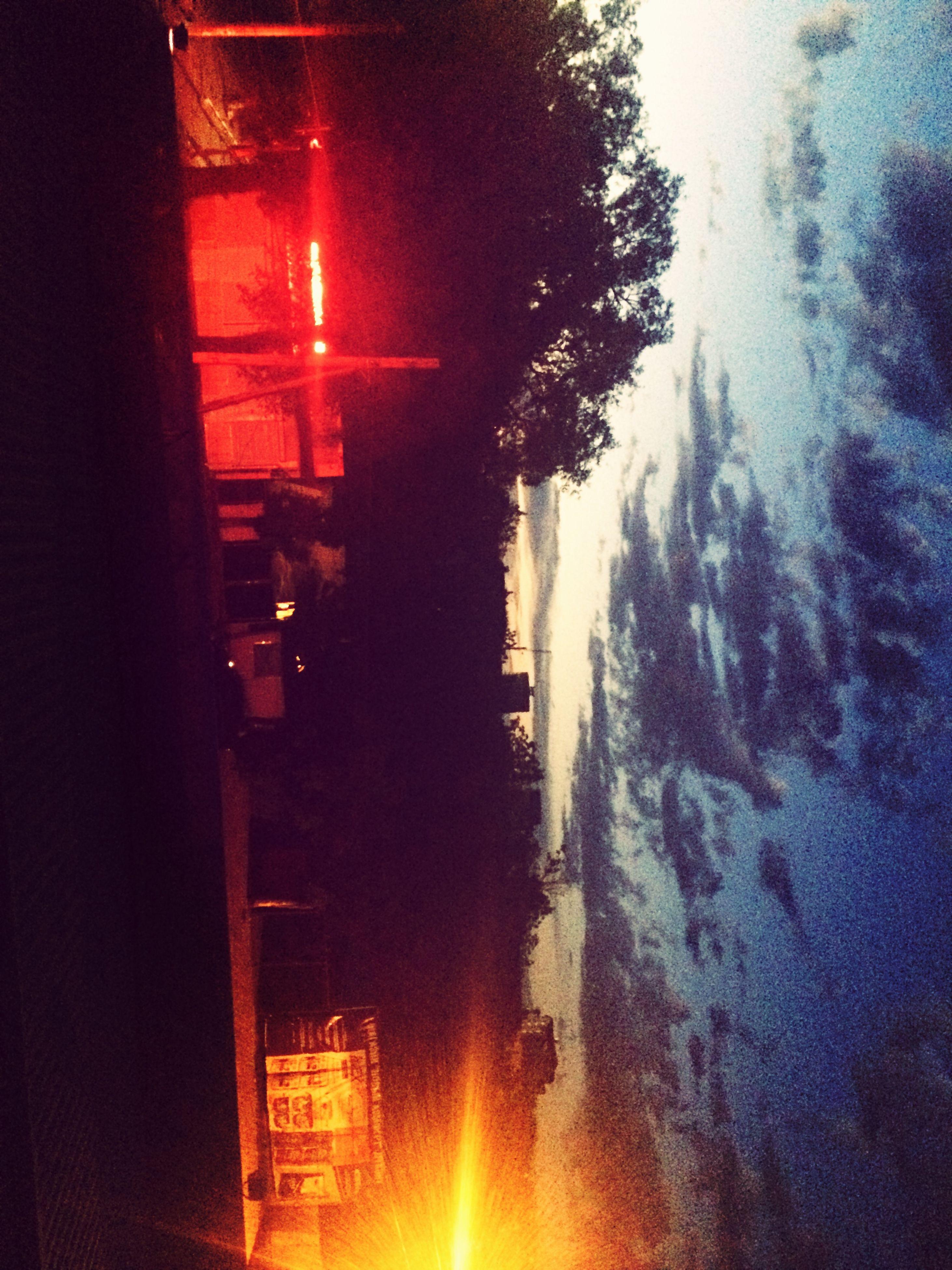 illuminated, snow, winter, cold temperature, building exterior, season, night, built structure, architecture, tree, street, sunset, weather, house, transportation, lighting equipment, street light, land vehicle, car, lens flare