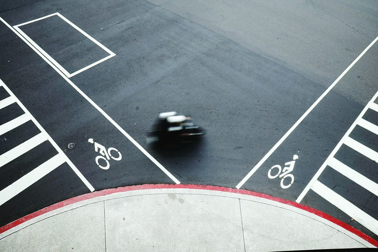 Flying High Asphalt Running Track Sports Race Sports Track Starting Line Urban Lifestyle Cityscape Motocycle Streetphotography Transportation High Angle View Street Signs