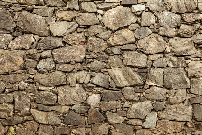 Rock wall in a sunny day Abundance Background Backgrounds Brick Wall Close-up Cracked Day Detail EyeEm Gallery Full Frame Grey Natural Pattern Nature No People Outdoors Repetition Rock Wall Rock Wall Texture Stone Stone - Object Stone Wall Texture Textured  Textures And Surfaces Wall