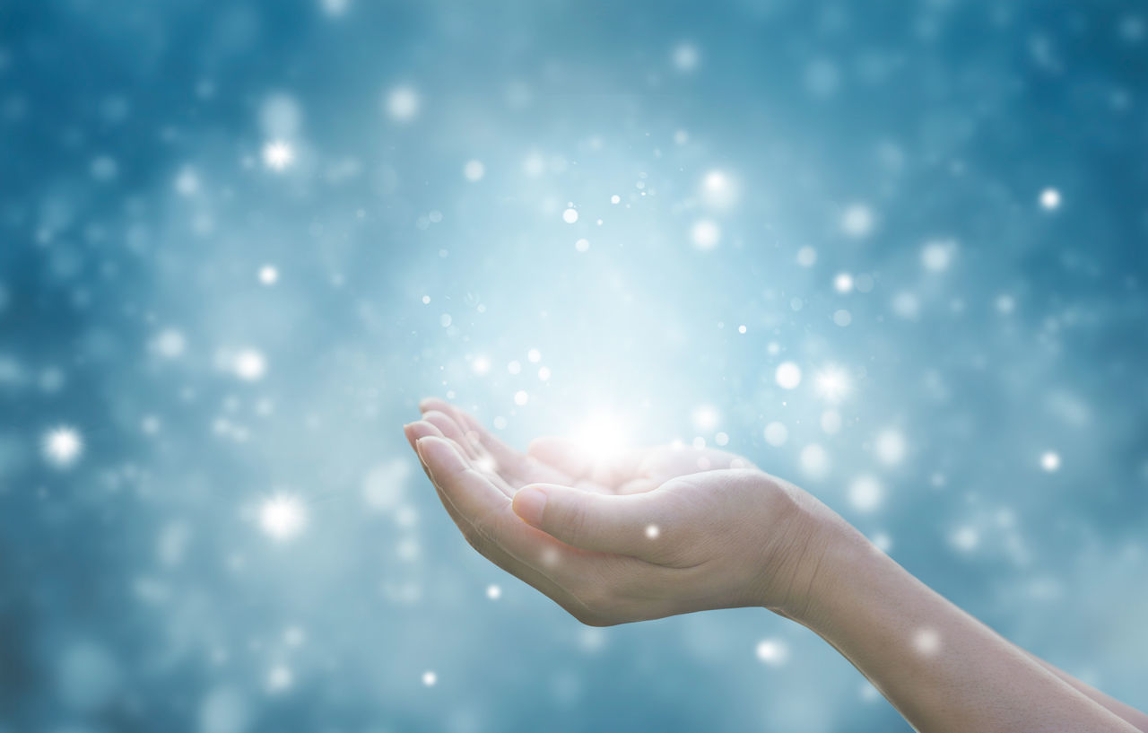 Christianity Christmas Forgiveness Magical Respect Soul Spirituality Blue Celebration Close-up Dust Faithful Human Body Part Human Hand Illuminated Lifestyles One Person Palm Hand Particle People Praying Religion Silence Snowflake Star Dust