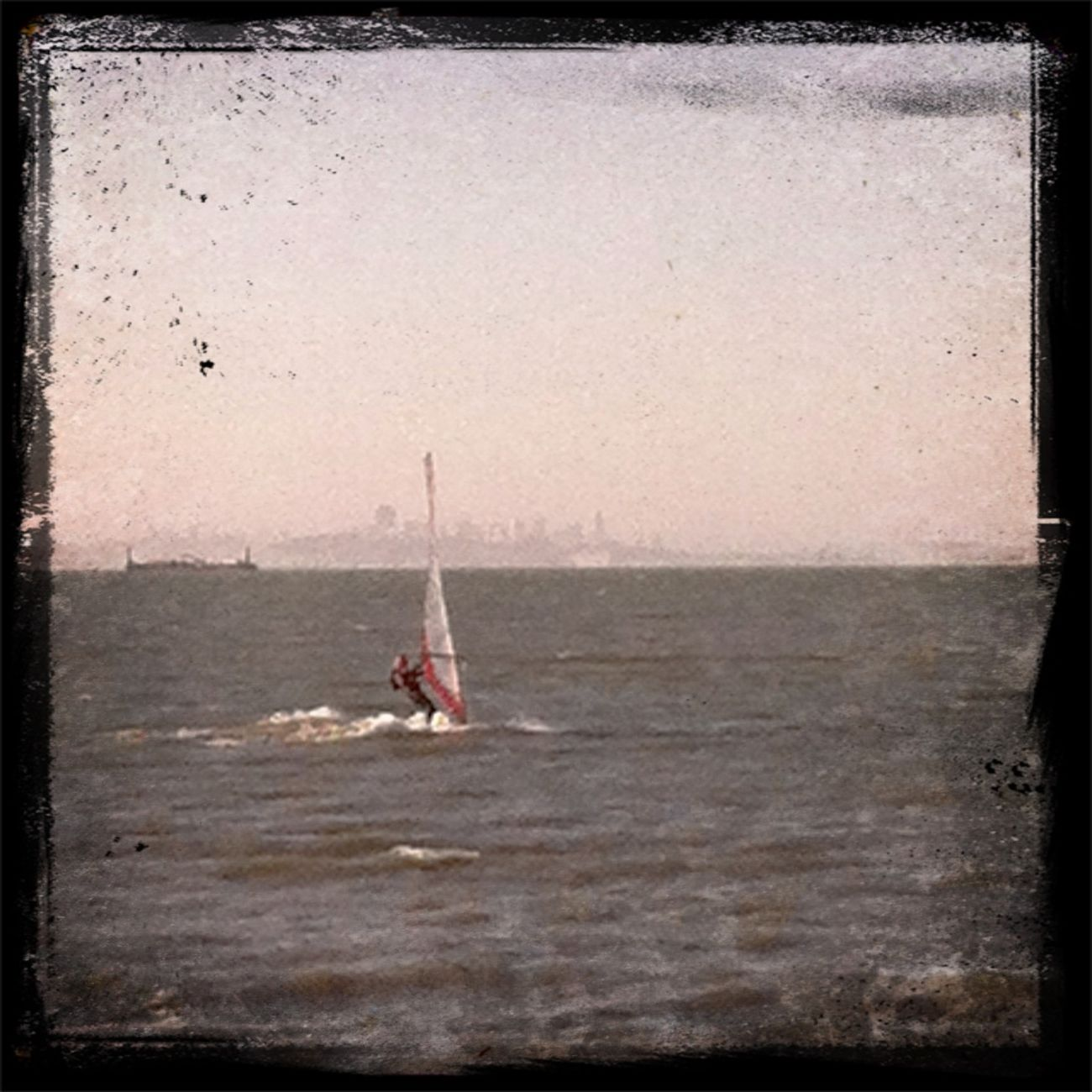 Bay Enjoying The Sun Windsurfing