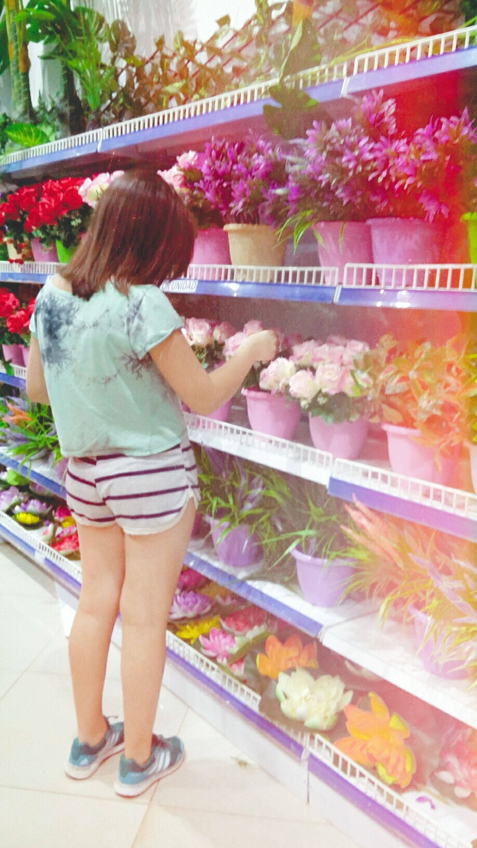 My little sister. Supermarket One Person Market Lifestyles Groceries Store Flowers Women Colorful Choice Argentina Photography First Eyeem Photo Outdoors Paraguayfotografia Day Efectos Fotograficos. Girl Power Girl Storephotography