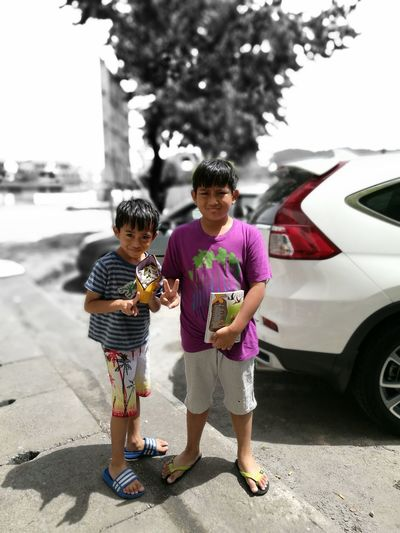 My boy Childhood Togetherness Bonding Full Length Togetherness Love Bonding Lifestyles Leisure Activity Childhood Casual Clothing Elementary Age Family Focus On Foreground Person Street Tree Sibling City Innocence Day