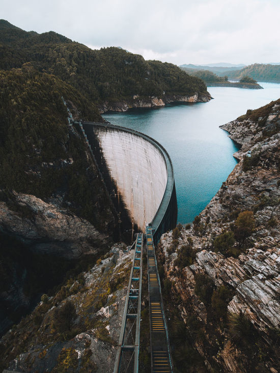 Architecture Beauty In Nature Bridge - Man Made Structure Built Structure Connection Dam Day Fuel And Power Generation High Angle View Hydroelectric Power Mountain Nature No People Outdoors Power Station River Sky Technology Transportation Water