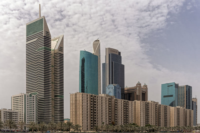 Dubai Business Residential Mix Architecture Building Exterior Built Structure Business Finance And Industry City Cityscape Day Downtown District Growth Modern No People Outdoors Residential Building Sky Skyscraper Tall - High Urban Skyline