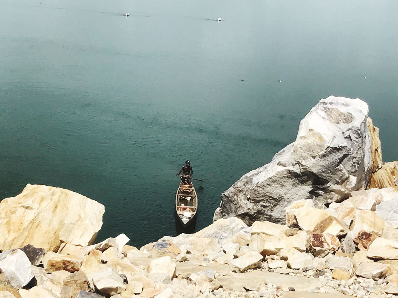 Lonely fisherman Water High Angle View Rock - Object Day Nature Outdoors Men One Person People Close-up Lifestyles Horizon Over Water Real People Mode Of Transport Leisure Activity Finding New Frontiers
