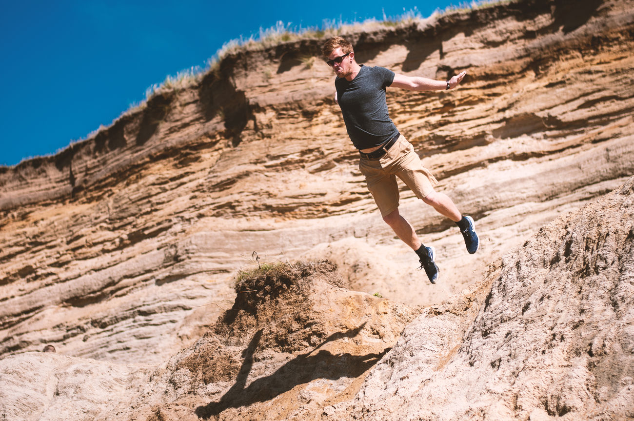 How much Red Bull is too much? Adult Adults Only Adventure Day Endurance Full Length Jumping Low Angle View Mid-air Motion Nature One Person One Young Woman Only Outdoors People Shorts Skill  Sky Sunlight Tree Vitality Young Adult