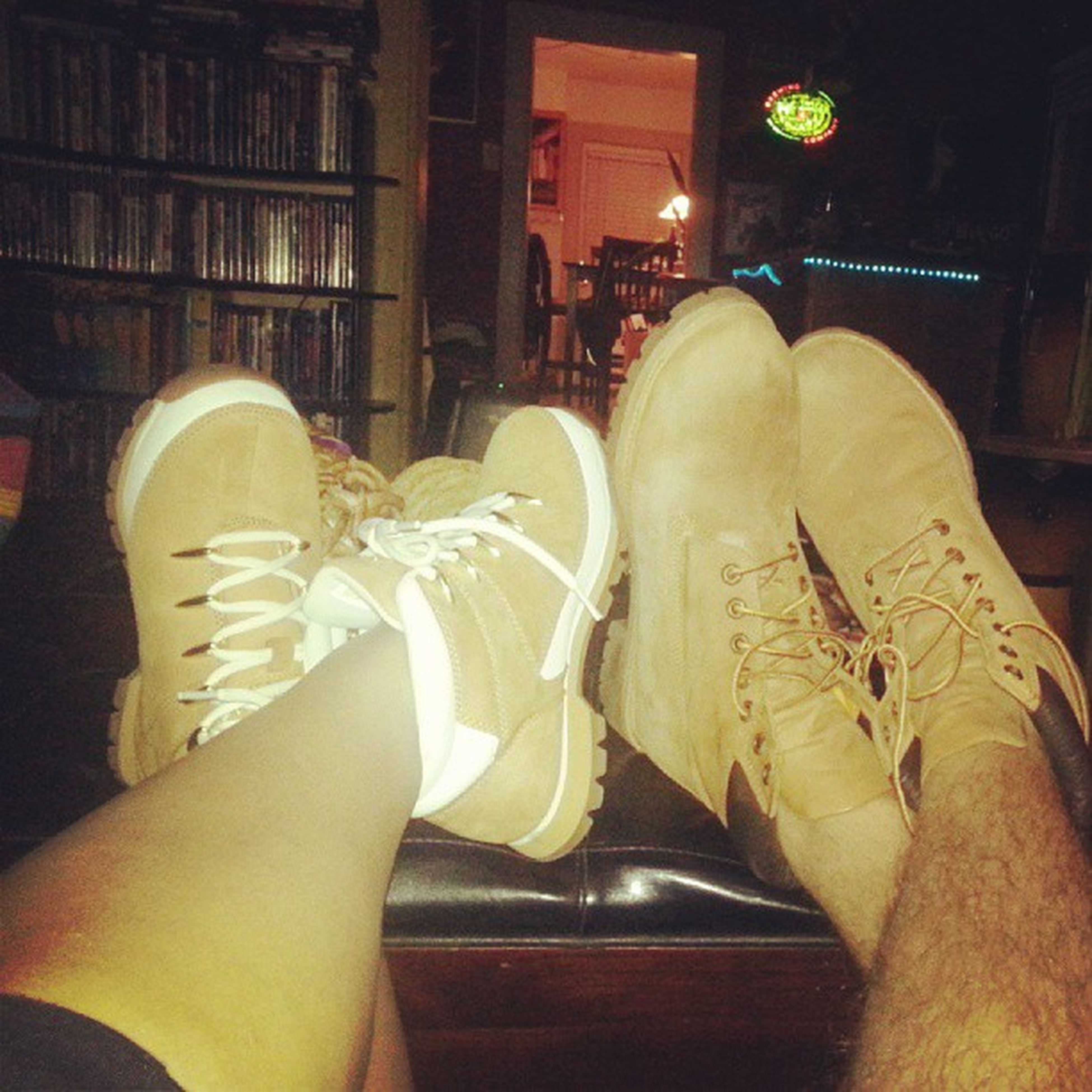 low section, person, indoors, lifestyles, personal perspective, sitting, leisure activity, men, shoe, human foot, relaxation, part of, footwear, standing
