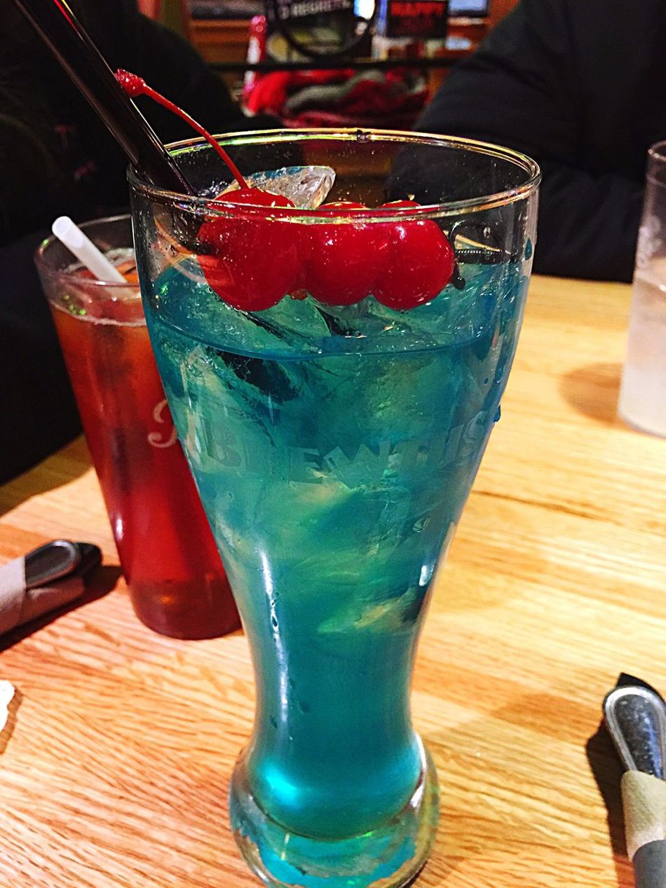 Something cool and refreshing to drink on SuperTuesday Longislandicedtea Blue Liqueur Alcohol Drinking Dinner Applebees Cherries Delicious