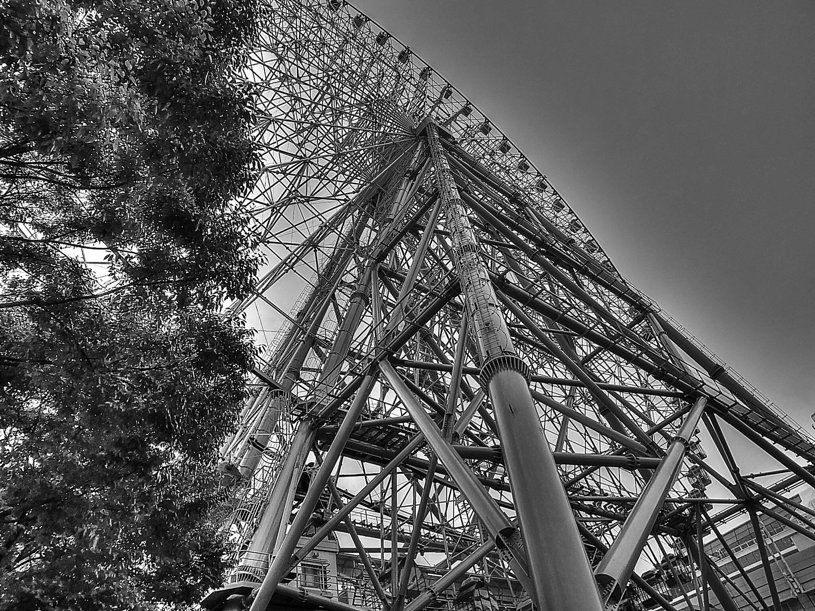 low angle view, built structure, architecture, metal, famous place, international landmark, engineering, sky, travel destinations, eiffel tower, travel, connection, capital cities, tower, tourism, metallic, bridge - man made structure, clear sky, tall - high, building exterior
