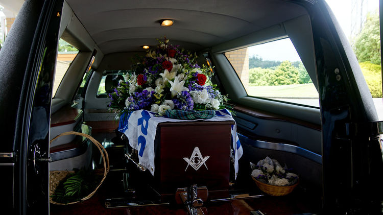 closeup shot of a colorful casket in a hearse or chapel before funeral or burial at cemetery Death Goodbye Love Grief Sadness And Sorrow Arrangement Casket Celebrate Life Coffin Farewell Funeral Hearse Insurance Mourn Old Age