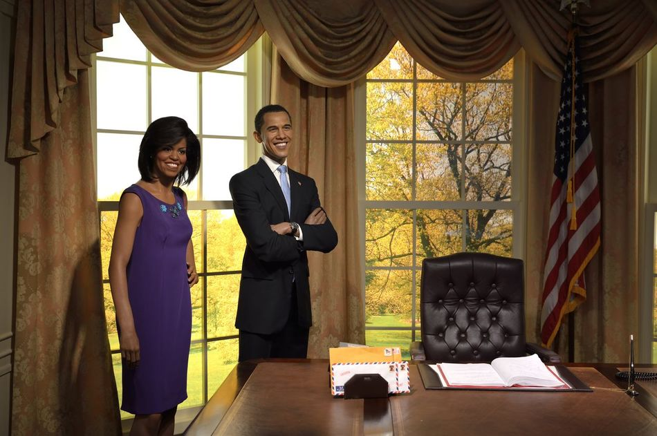 Barack Obama Cultures Fashion Front View Full Length Fun Home Interior Indoors  Leisure Activity Lifestyles Madame Tussauds Men Music Occupation Real People Side View Sitting Standing Three Quarter Length Wax Dolls Wax Museum Window Women