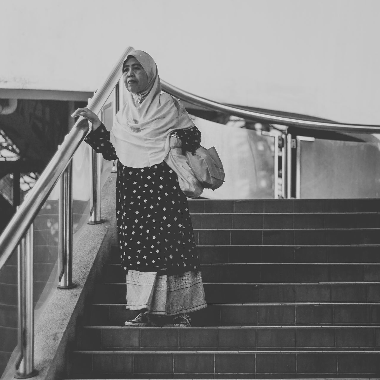 steps, staircase, railing, steps and staircases, real people, full length, lifestyles, casual clothing, standing, young women, leisure activity, low angle view, young adult, day, hand rail, indoors, people