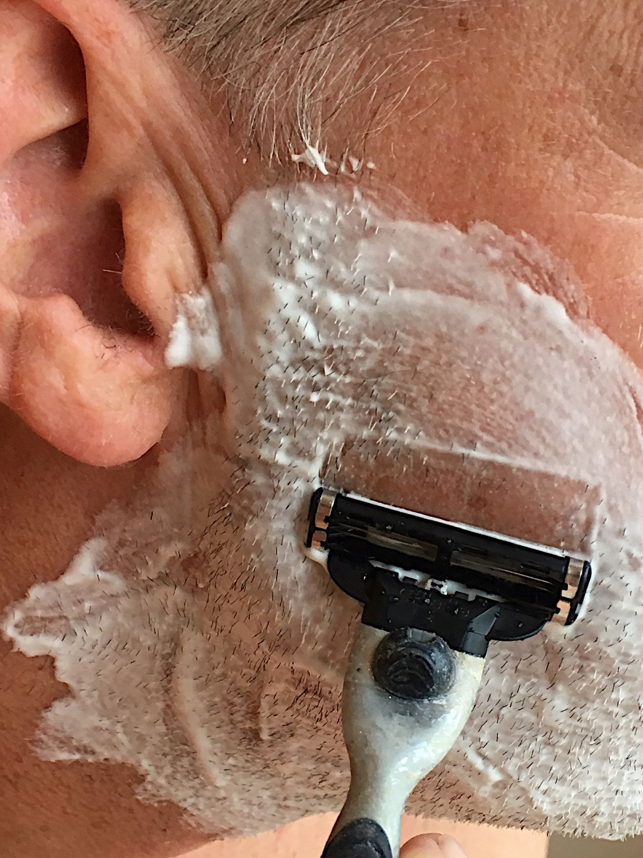 A Close Shave! One Person Human Body Part Only Men Adult One Man Only Indoors  Holding Razor Close-up Grooming Colour Image