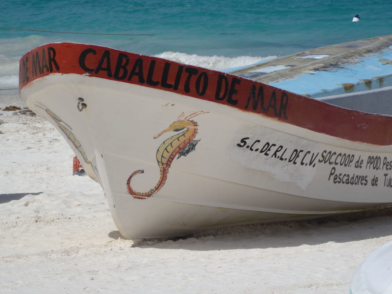 text, western script, communication, beach, sand, water, sea, day, outdoors, nautical vessel, no people, nature, close-up