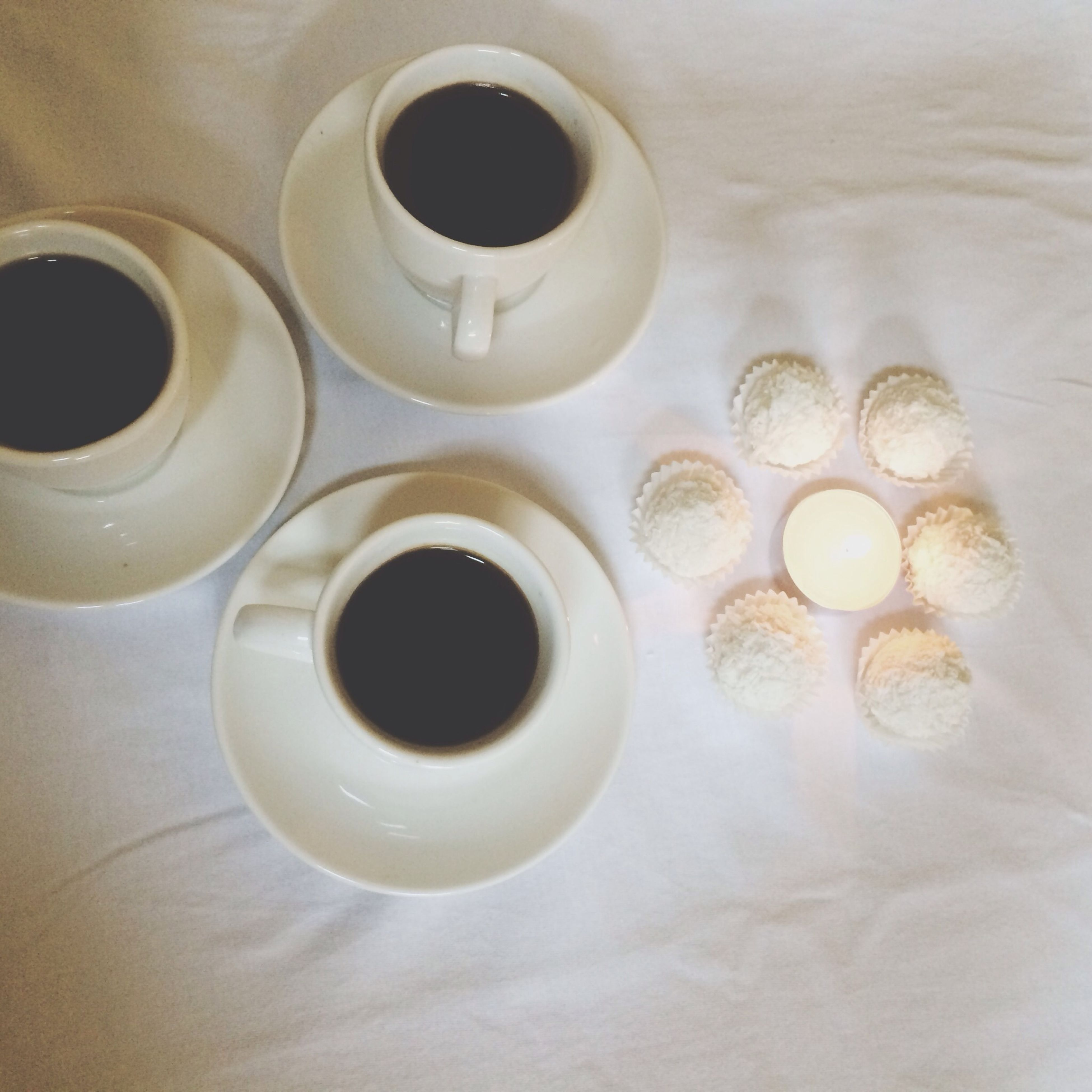 coffee cup, drink, indoors, food and drink, refreshment, coffee - drink, saucer, cup, table, still life, freshness, coffee, tea cup, high angle view, close-up, directly above, spoon, tea, beverage, white color