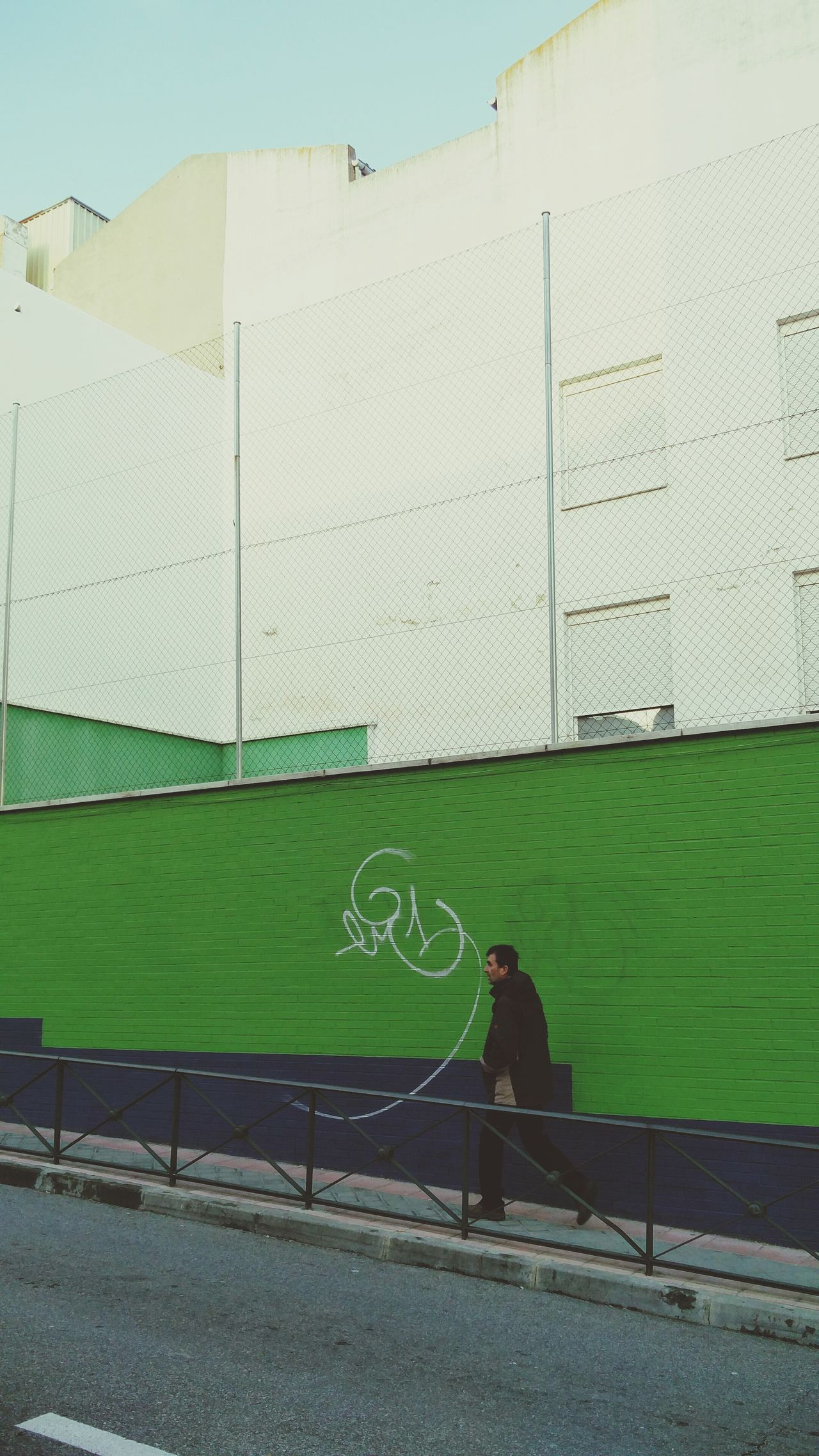 Back facade One Man Only Adult One Person Day Outdoors Green Color Architecture Close-up Texture And Surfaces The City Light Creativity Madrid Green Lasuma Concrete Wall Concrete Wall Man Made Object Street Urban Streetphotography