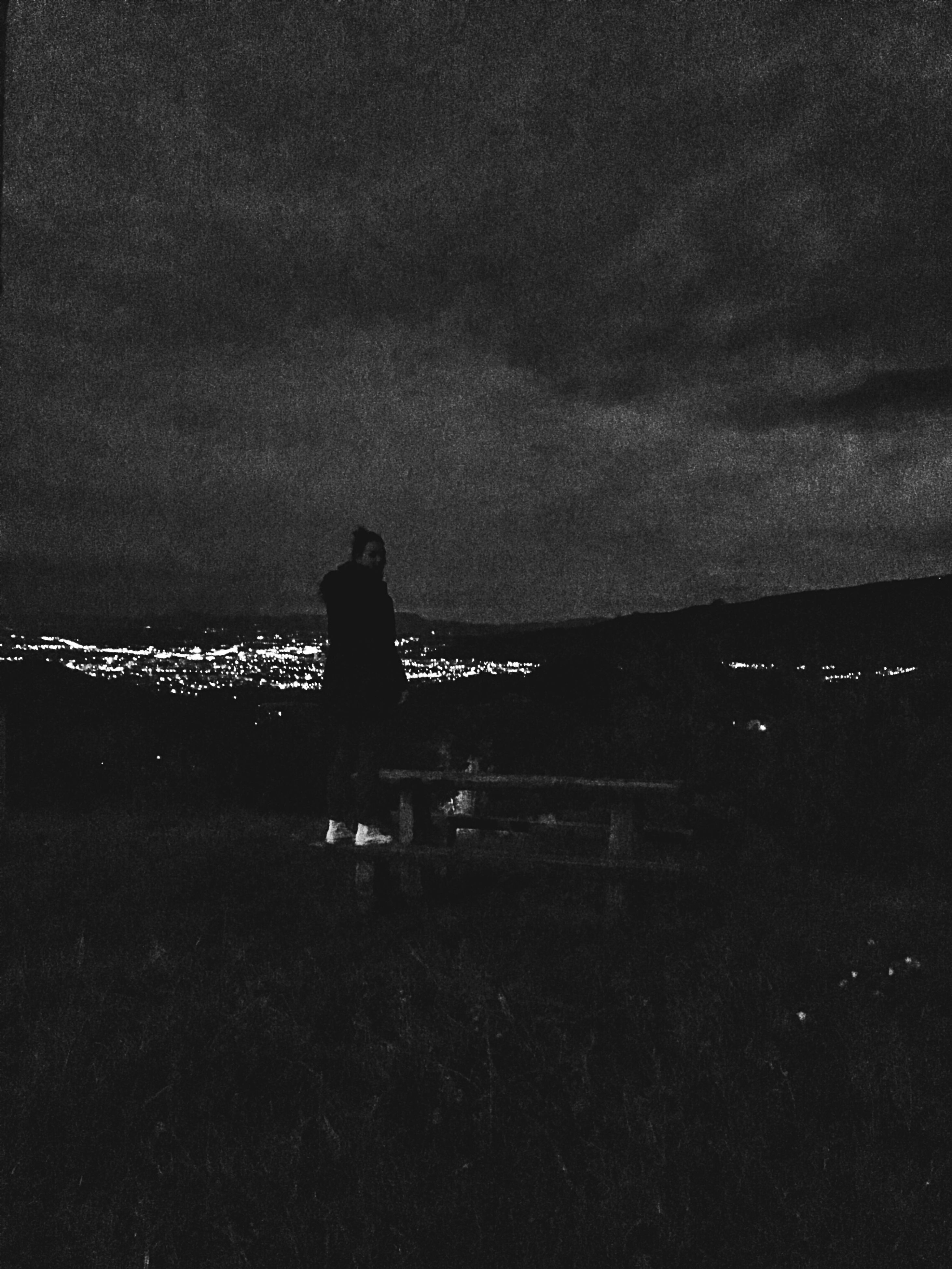 silhouette, men, lifestyles, sky, leisure activity, standing, rear view, person, dusk, sitting, night, built structure, dark, unrecognizable person, full length, cloud - sky, togetherness