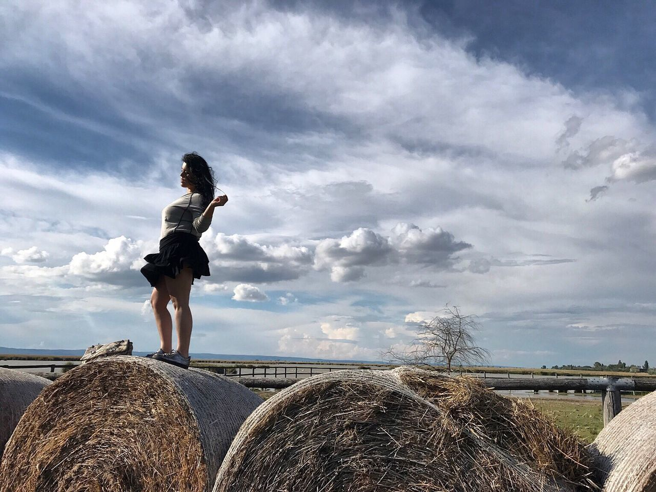 The Great Outdoors - 2017 EyeEm Awards Cloud - Sky Sky Full Length Hay Bale  One Person Day Lifestyles Field Outdoors Leisure Activity Agriculture Standing Nature Beauty In Nature Young Adult People