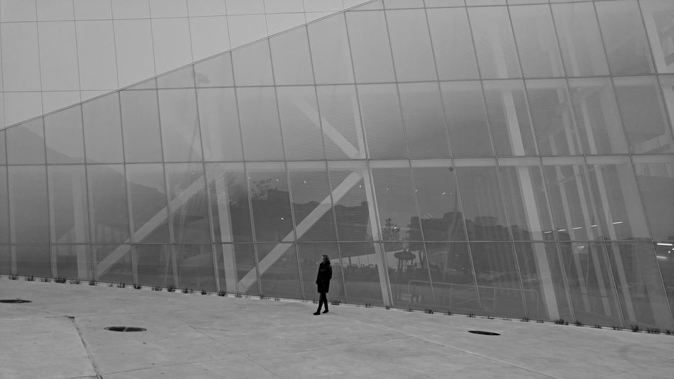 We are one Glass And Steel Modern Architecture Slanted Building Unique Silhouette Perspective Black And White Oblique Angle Futuristic Design Cityscapes Modern Architecture One Person Montréal Canada