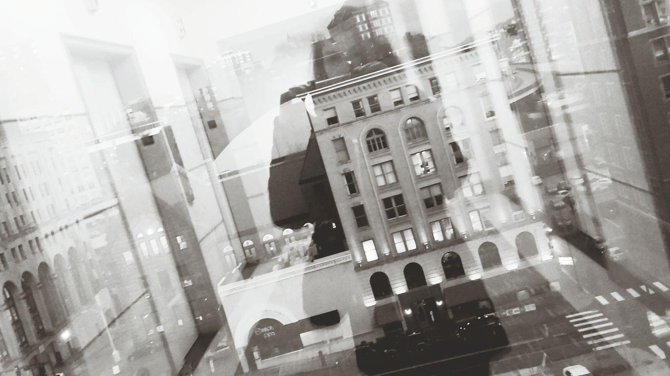 Blackandwhitephotography Blackandwhite Reflection_collection Reflection Reflection Photography Photographer In The Shot Creativity CreativePhotographer Creativeshots Downtownpittsburgh Lookingthroughthewindow Lookingoutside Elevated View Elevator Door Reflectionsinthewindow Architecturephotography Eyeemphotography Design Cars Street Beautyisintheeyeofthebeholder