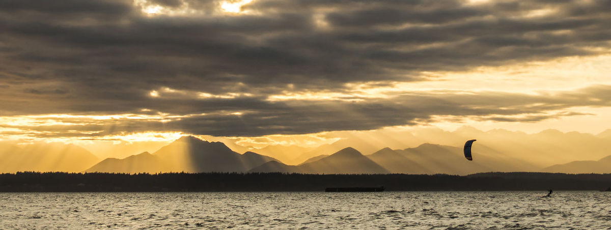 Golden rays of sunset at Golden Gardens Silhouette Beauty In Nature Cloud - Sky Crepuscular Rays Day Golden Gardens Park Golden Hour Mountain Nature Olympic Mountains Outdoors Scenics Sea Silhouette Sky Sunset Tranquil Scene Tranquility Water EyeEmNewHere EyeEm Nature Lover Paint The Town Yellow Been There. Lost In The Landscape