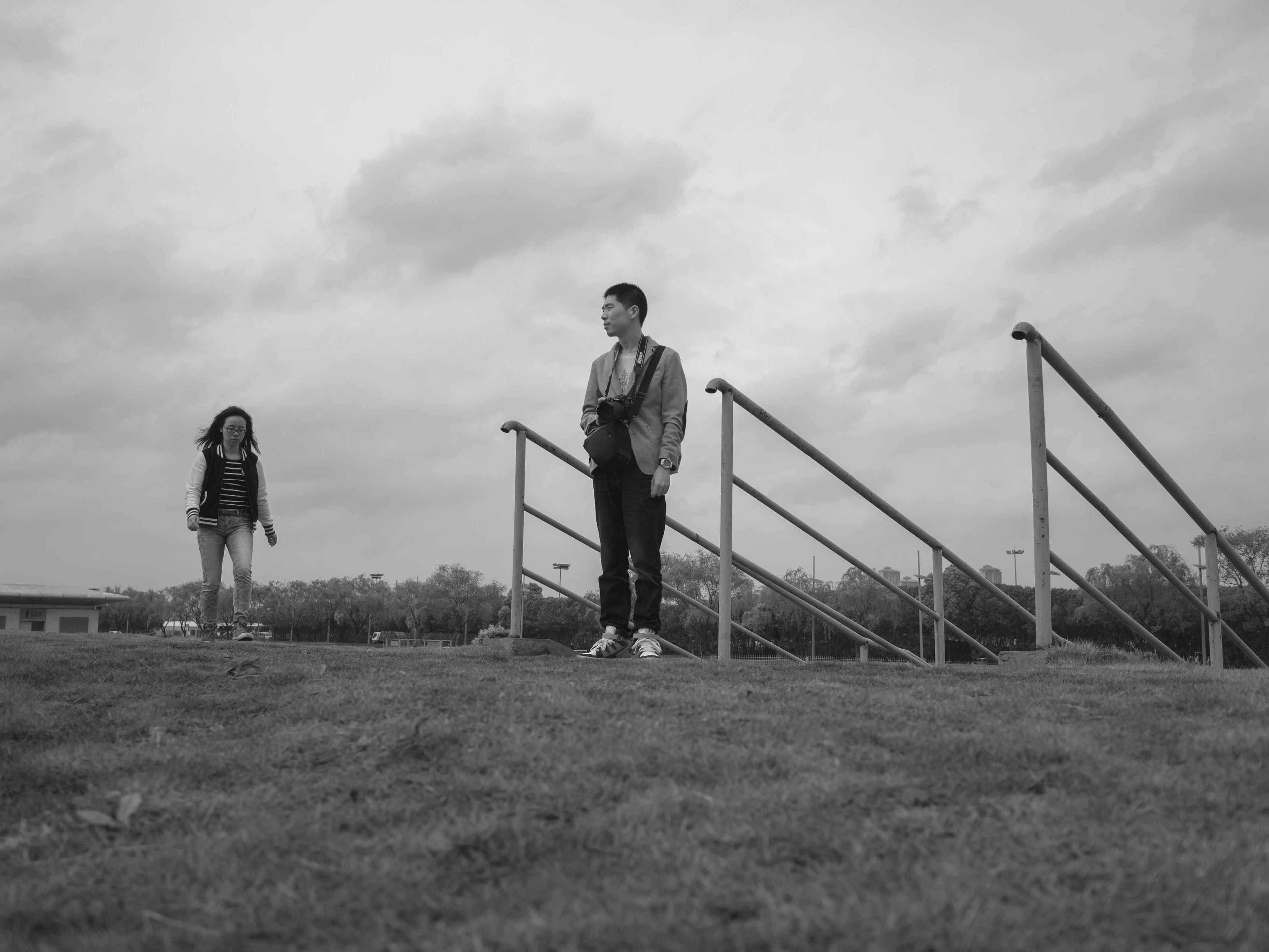 sky, full length, lifestyles, leisure activity, cloud - sky, standing, casual clothing, grass, field, childhood, cloudy, cloud, rear view, protection, day, outdoors, safety, nature