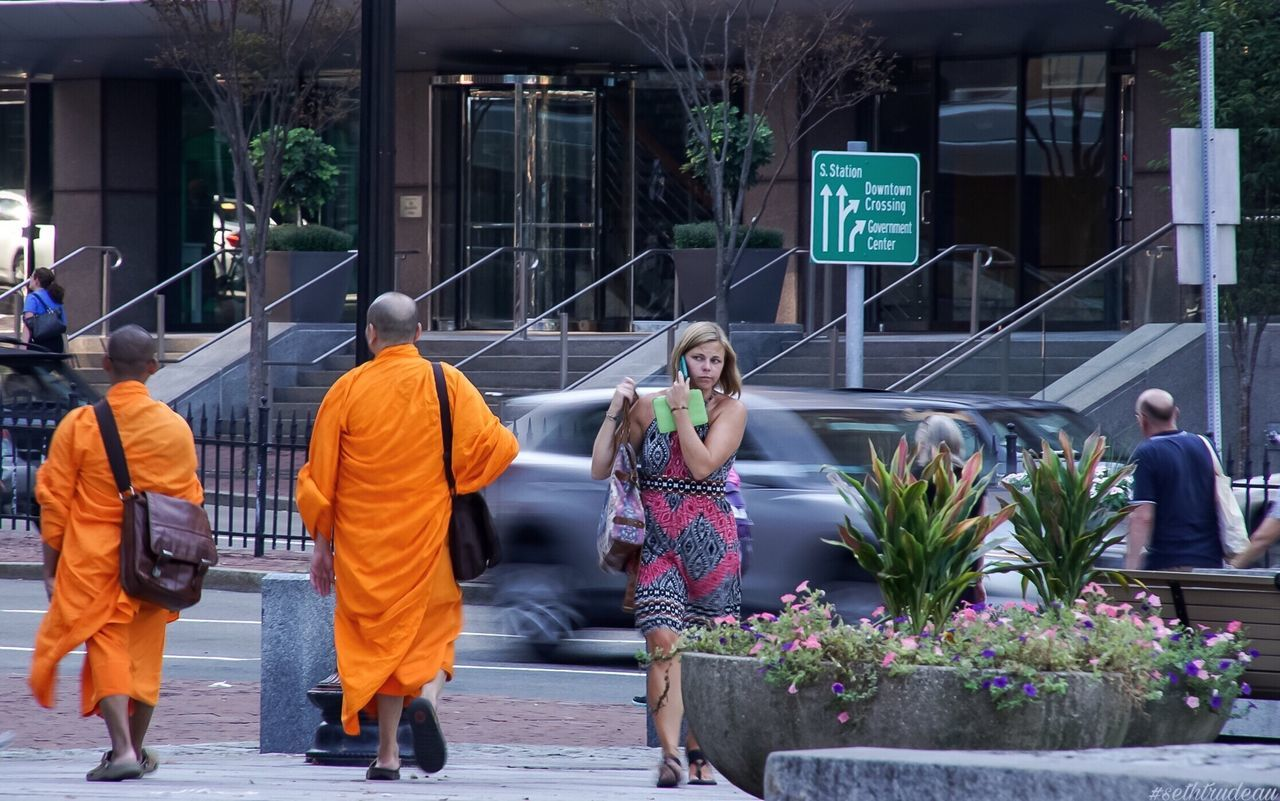 City Life Women Men Real People Outdoors Flower Adults Only People Adult Day Budhism Budhist Buddhist Monks Sethtrudeau Photography Orange Orange Color City City Life Life Stand Out From The Crowd Standing Out Stand Out