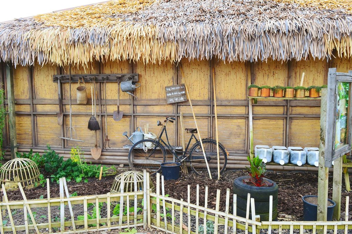 Outdoors Building Exterior Thatched Roof Beach Hut Shack Garden Garden Photography Bike Old Bicycle No People Day Roof Architecture Nature Beauty In Nature Fence Tranquil Scene Travel Destinations The Great Outdoors - 2017 EyeEm Awards Garden Tools Vegetables