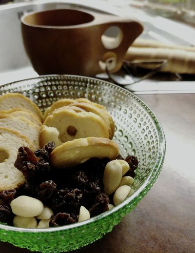 Food And Drink Food Indulgence Bowl Close-up Ready-to-eat No People Indoors  Green Glass Snacktime Kuksa Raisins With Nuts Selective Focus Dark And Light Decorative Atmosphere Baked