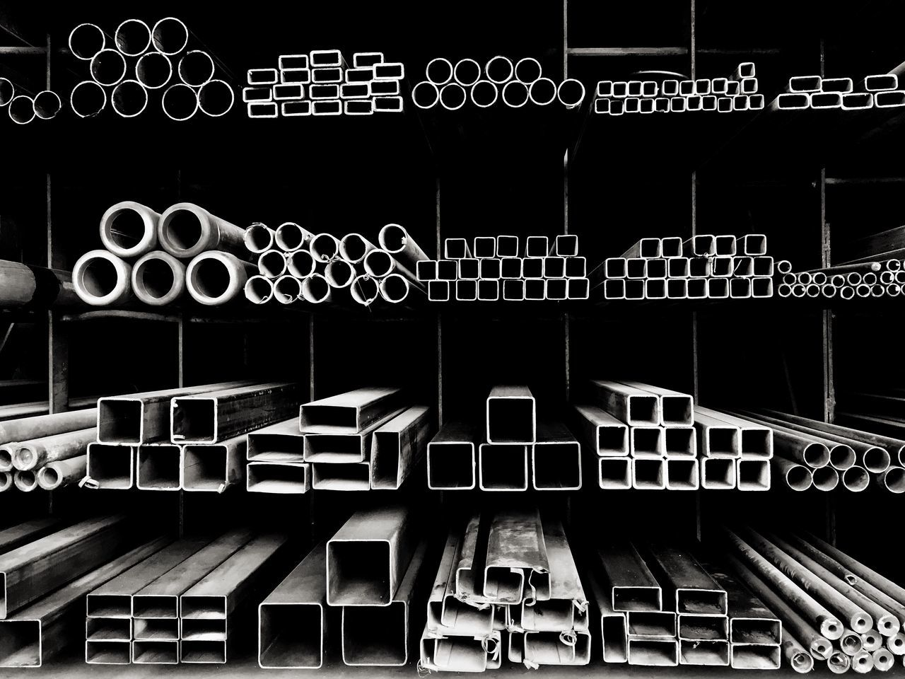 Metal bars, beams and pipes are stacked for sale at a hardware store in Bangkok. In A Row Shelf Empty Large Group Of Objects No People Repetition Pattern, Texture, Shape And Form Blackandwhite Black And White Black & White Metal Beams Beams, Pipes, Tubes Hardware Store EyeEm Best Shots EyeEm Gallery EyeEmBestPics Art Is Everywhere