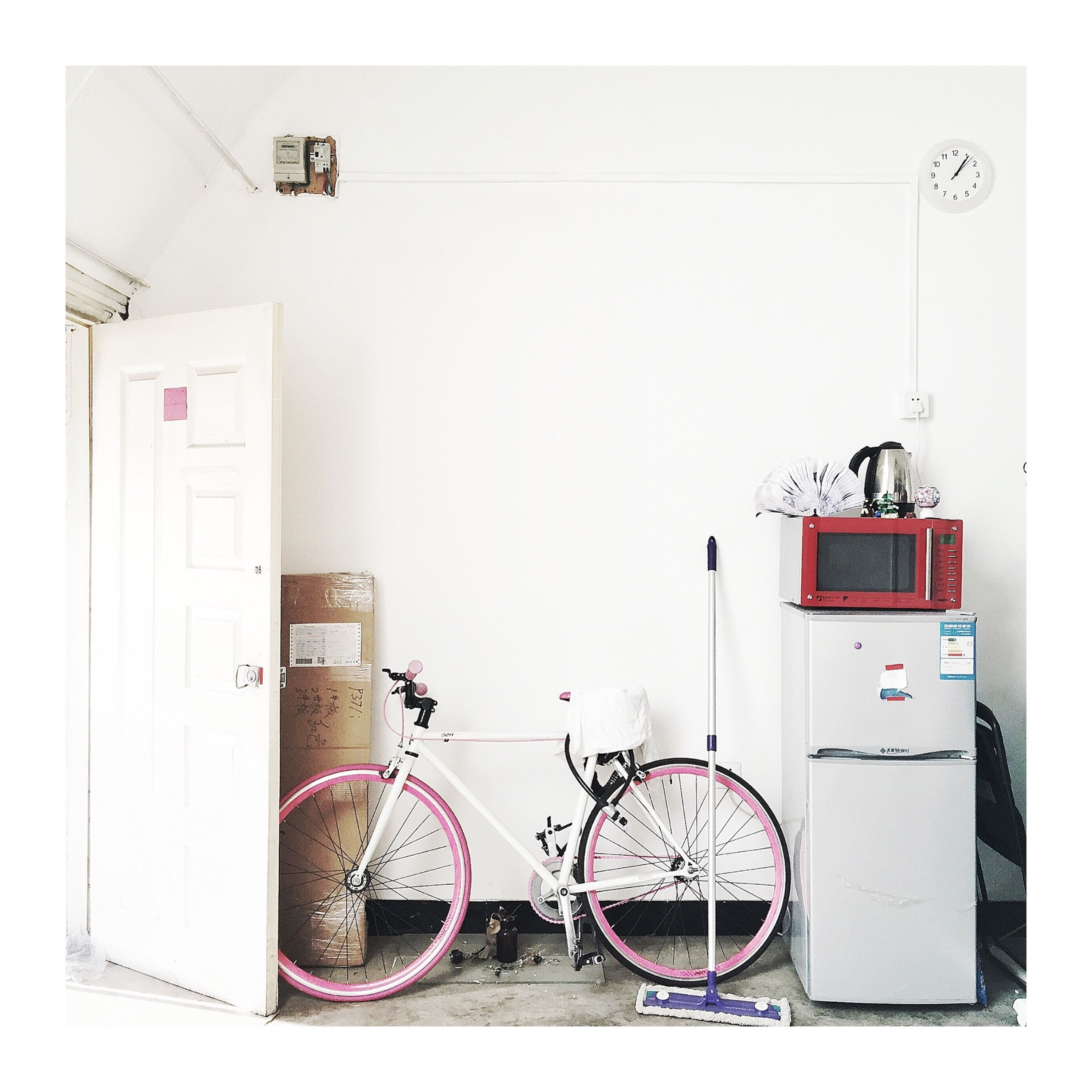 indoors, built structure, architecture, wall - building feature, wall, communication, transfer print, transportation, technology, auto post production filter, door, no people, day, white color, connection, mode of transport, absence, stationary, bicycle, building exterior