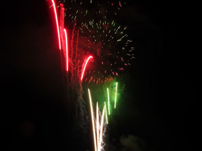 Colorful fireworks of various colors light up the night sky Anniversary Background Black Bright Burst Celebrate Celebration Dark Display Event Exploding Explosion Festive Fire Firework Fireworks Fourth Of July Holiday Isolated On Black Light New Year Night Pyrotechnics Show Sky
