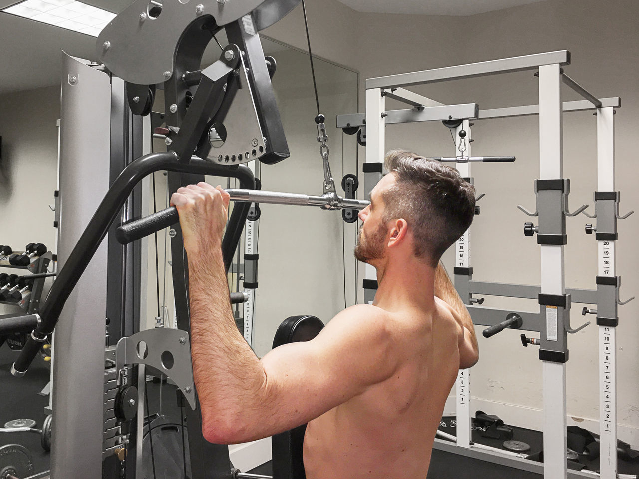 Man doing lat pulldowns at the gym Adult Adults Only Athlete Business Finance And Industry Close-up Day Gym Health Club Healthy Lifestyle Human Body Part Hygiene Indoors  Lifestyles Men Mid Adult Muscular Build One Man Only One Person Only Men People Sports Training Strength Wellbeing