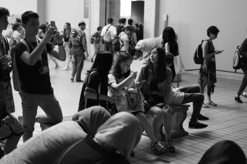 Bored tourists at the British Museum, No 3 Street Photography Museum Tourists Bored Phones Sitting People Watching Black And White Showcase July Eyeemphoto