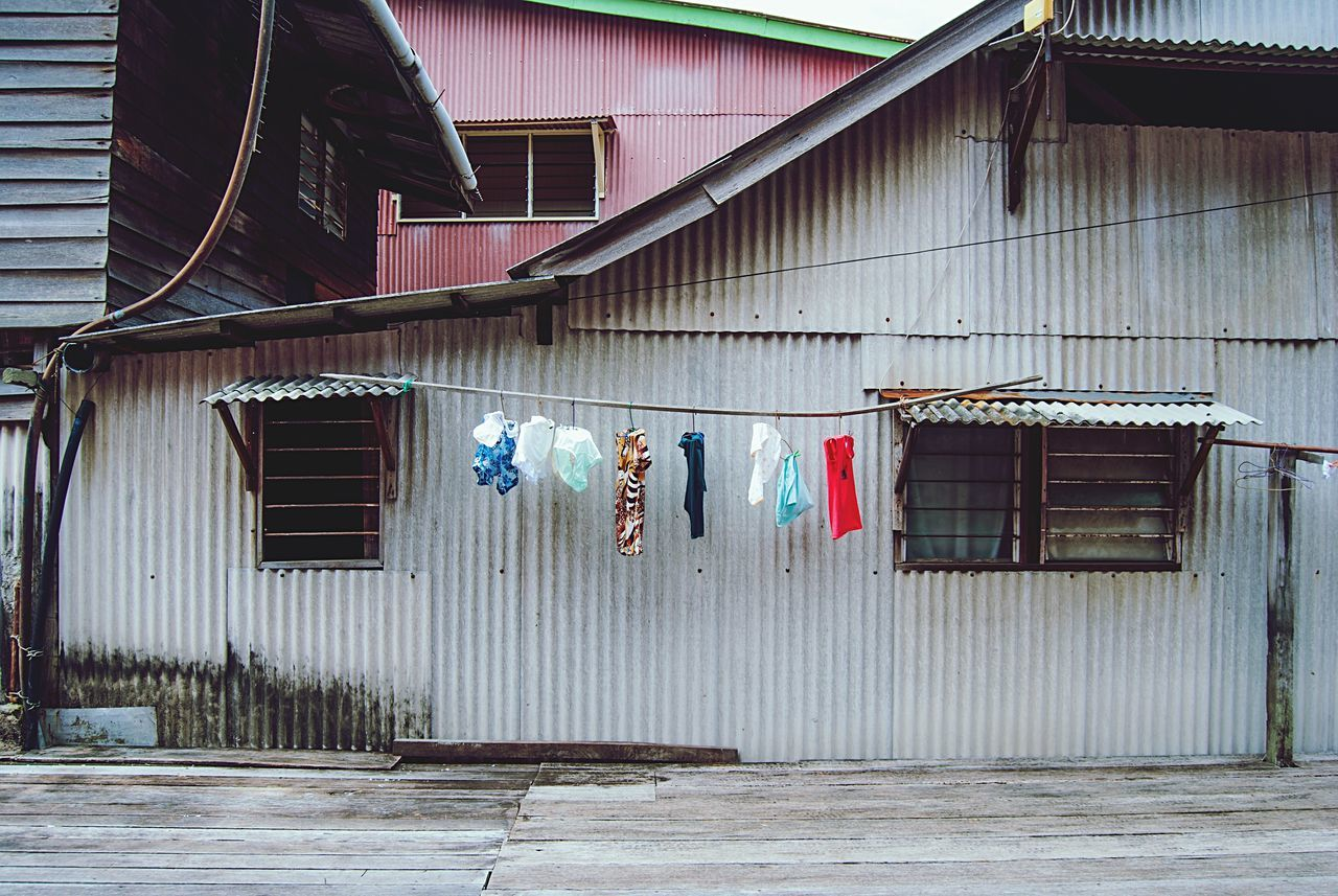 Building Exterior Architecture Built Structure Hanging Laundry No People Drying Colorful Authentic Georgetown Penang Malaysia Southeastasia Asian  Culture Building Day Streetphotography Travel Travel Photography Contemporary
