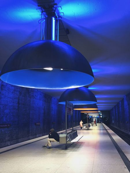 Connected By Travel Illuminated Indoors  Architecture Real People Lifestyles Full Length Built Structure Men Sitting Modern One Person People Adult Munich Subway Subway Station